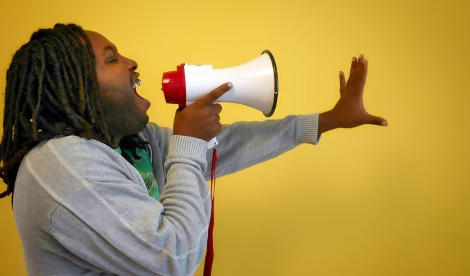 Man Promoting His Message on a Megaphone - Illustrating Content Promotion Technique