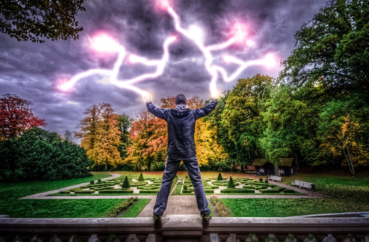 Man harnessing lighting to illustrate power of image SEO.