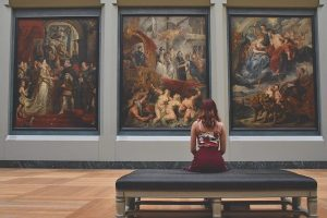Image of a woman looking at art to illustrate content imagery tools.