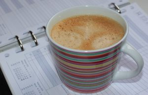 Coffee on a planner to illustrate content planning tools.