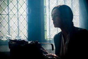 Image of a woman writing to illustrate content writing tools.